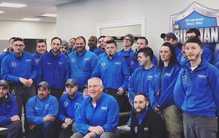 the connecticut pest elimination technicians gathered together for a photo at the office in orange connecticut