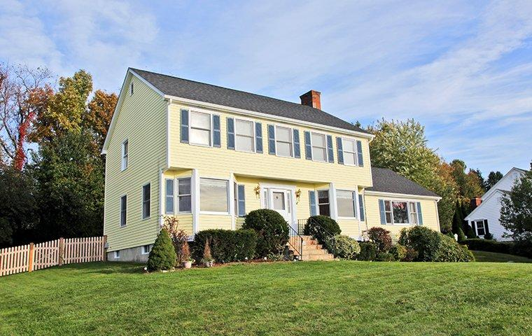 street view of a two story yellow house in hamden connecticut
