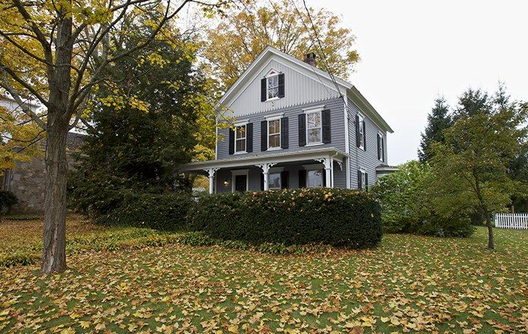 a white three story home in trumbull connecticut