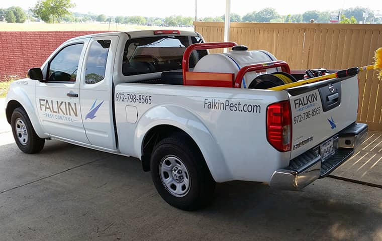 a falkin pest control company vehicle parked outside of a home in denver colorado