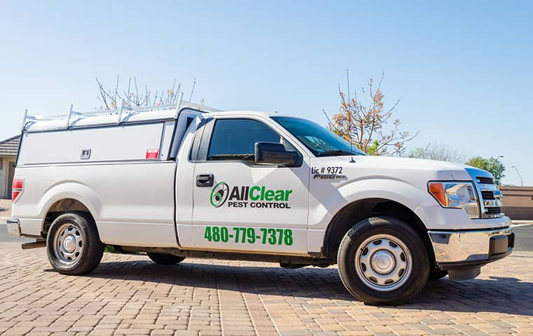 all clear pest control company vehicle parked outside a home in queen creek arizona