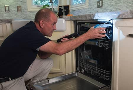 technician inspecting tulsa home for pests