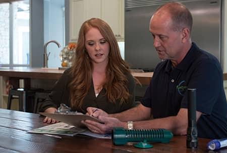 technician explaining benefits of termite control
