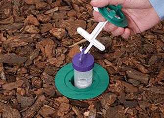 tech monitoring a termite station