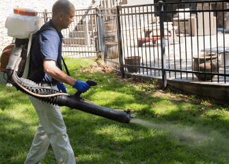montgomery exterminating tech treating yard for fleas and ticks