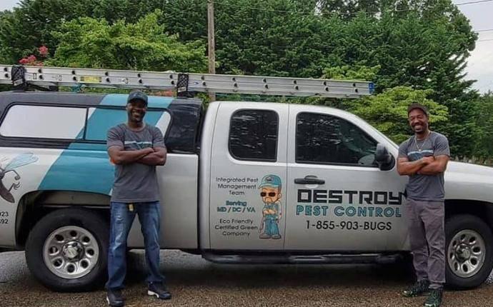 pest control technicians in front of van