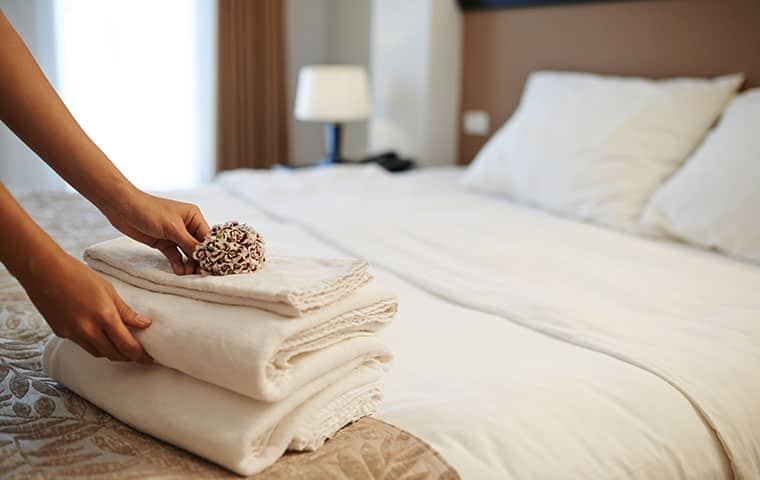 a hospitality worker folding towels in a edenton north carolina hotel room