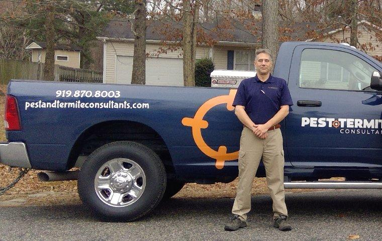 a pest control technician servicing a raleigh north carolina home
