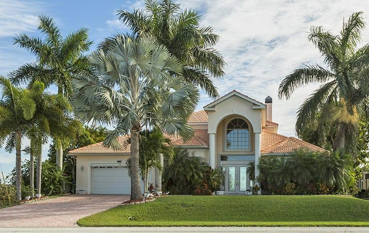 street view of a large boynton beach florida home and palm trees