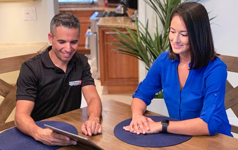 a homeowner meeting with a gotbugsikill service professional inside of a home in boca raton florida