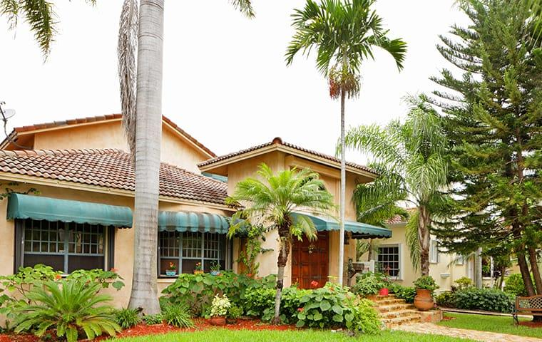 street view of a large delray beach florida home and yard