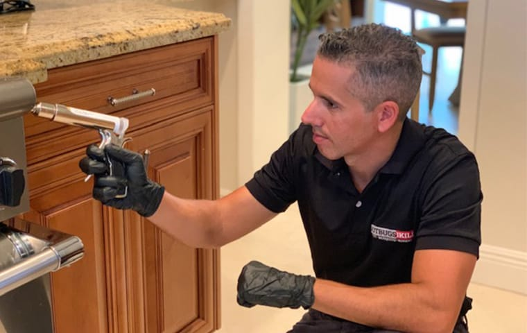 gotbugsikill technician applying pest control products that are pet and family friendly in boca raton florida