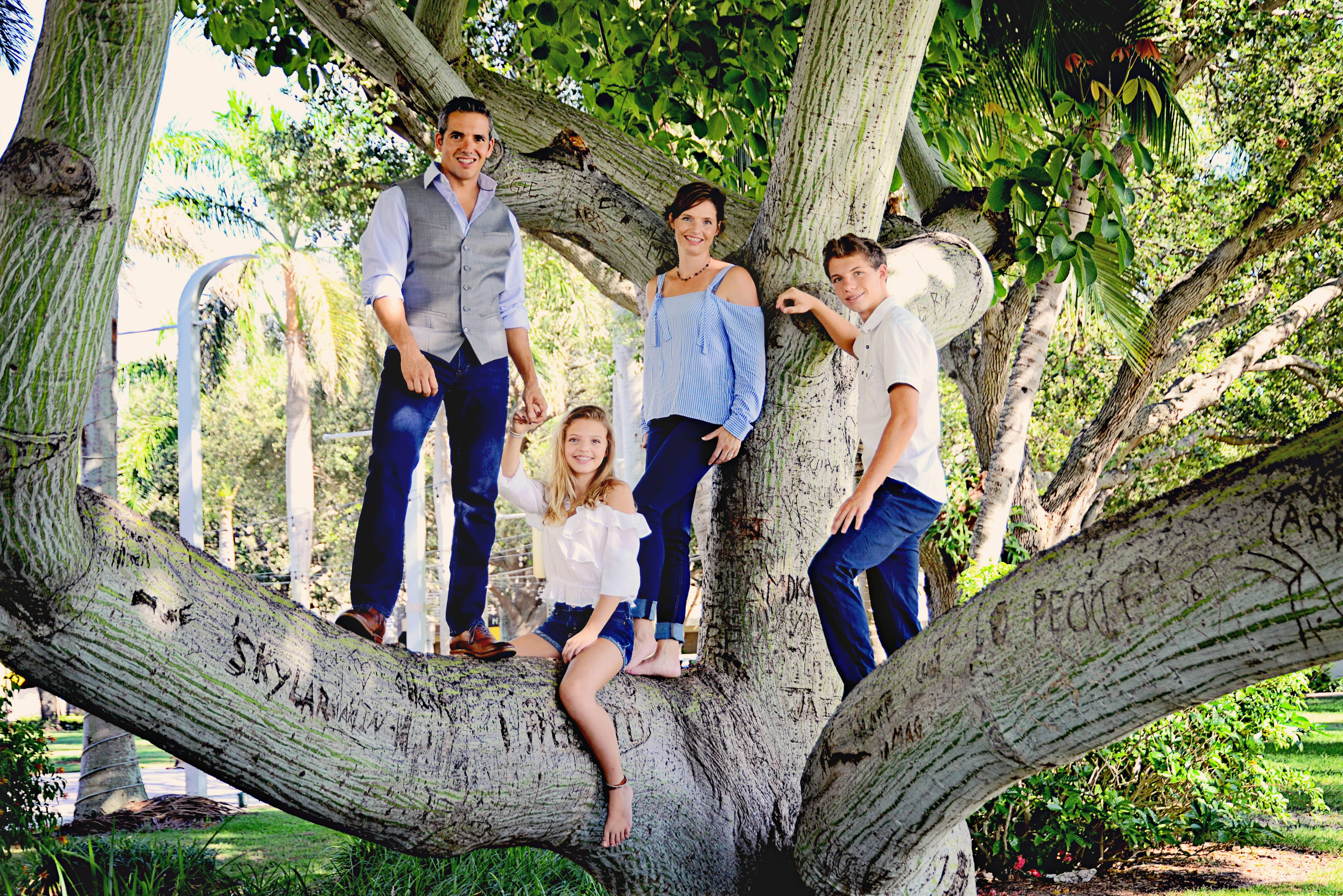 owner of gotbugsikill and his family standing in a tree in boca raton
