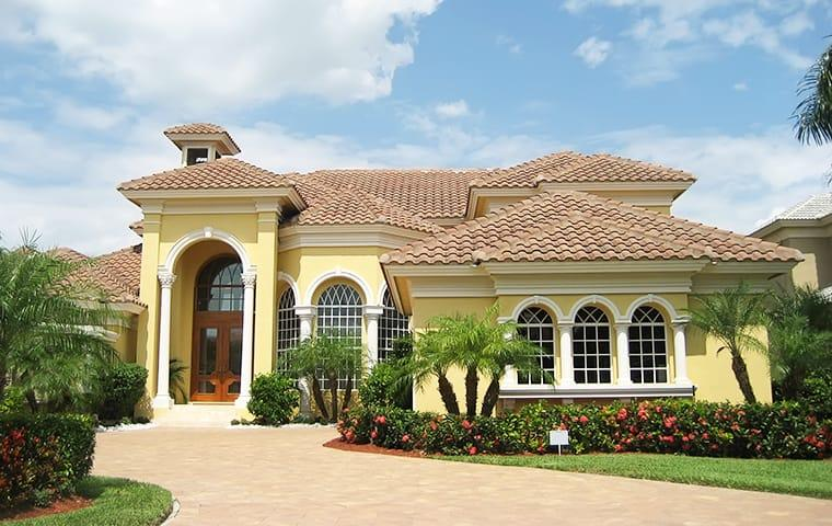 street view of a large yellow house in parkland florida