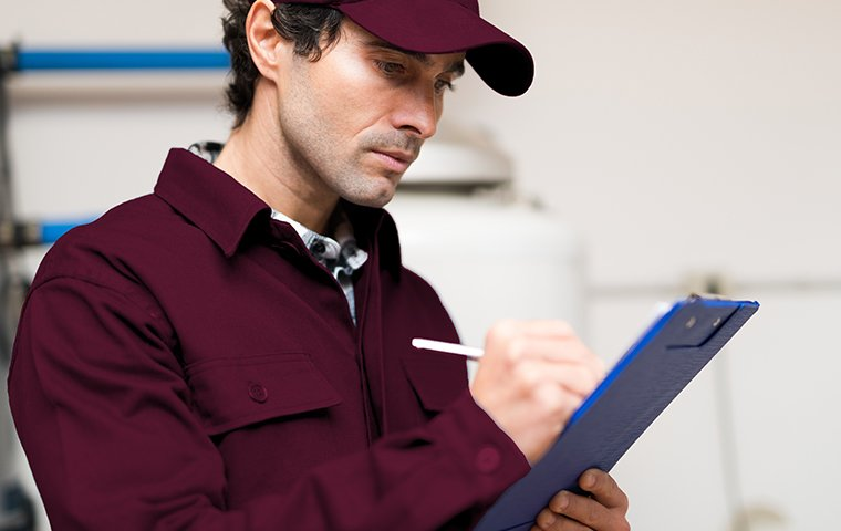tech inspecting with a clipboard