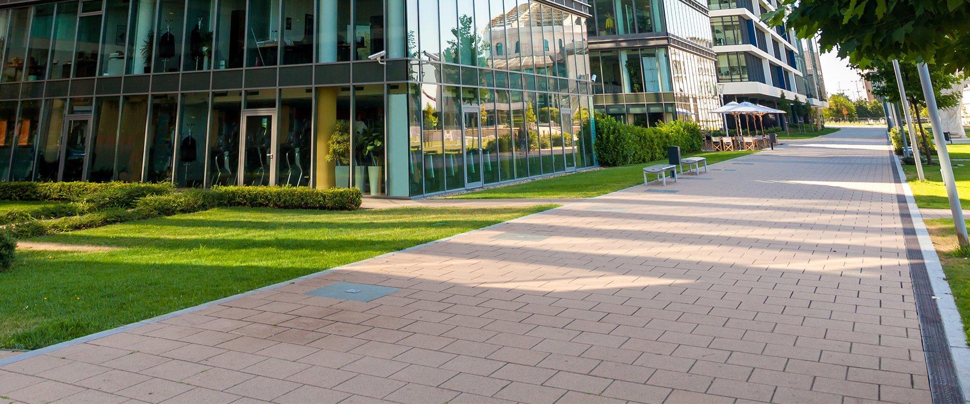 sidewalk near a commercial office building