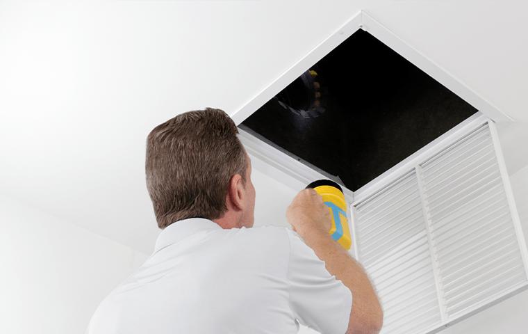 tech inspecting a home