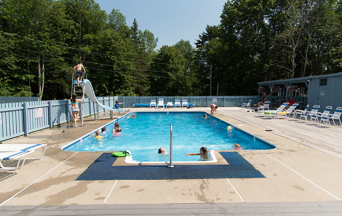 heated pool with slide at campground on mount desert island