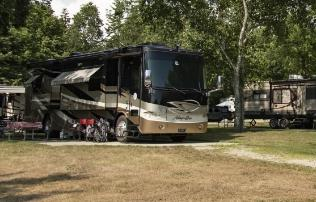 full hook up site with cement pad for rvs at campground near acadia national park