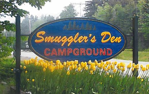 road sign for smuggler's den campground