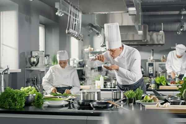 commercial kitchen interior with chefs at work