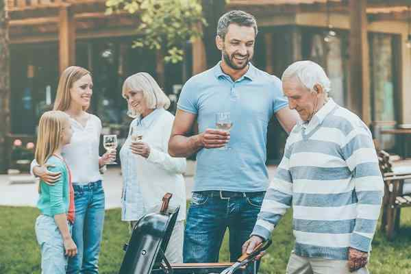 a family with a bbq in back yard