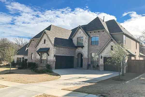 street view of brick home in conroe texas