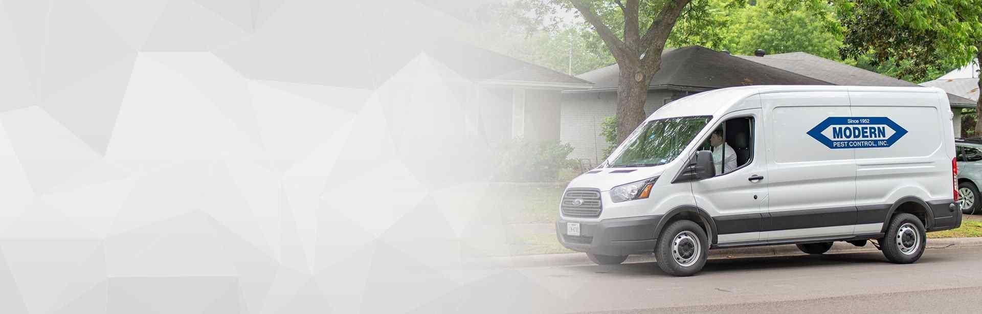 modern pest control van in front of texas home