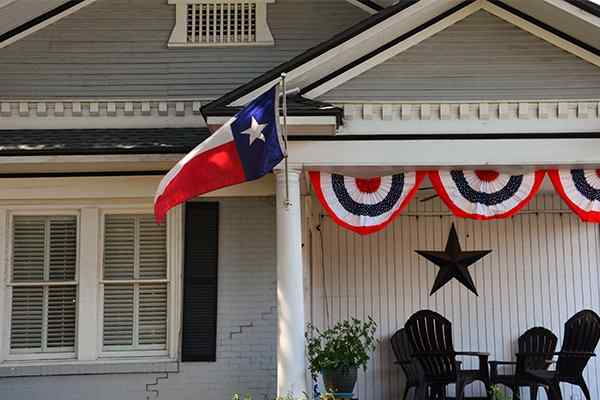 house with texas flag hanging on fron porch