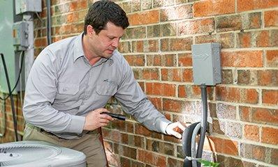 technician outside of home