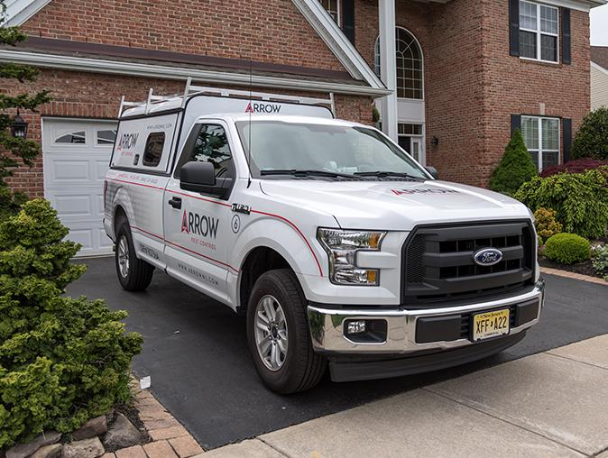 arrow pest control service truck in nj
