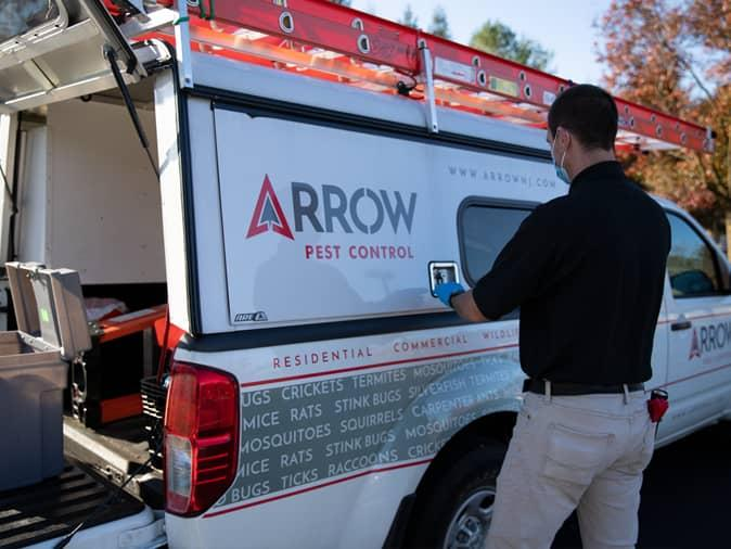 tech getting ready for professional bed bug treatment in new jersey home