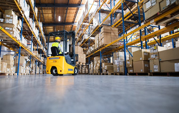 a big warehouse and a forklift