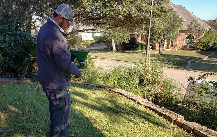 dancan technician servicing a yard for rodents in keller texas