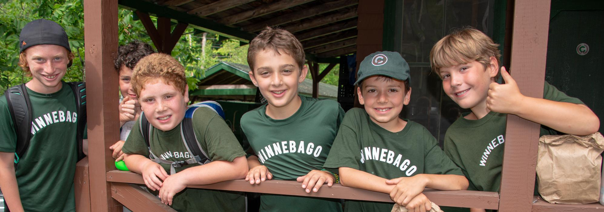 Boys in front of Cabin