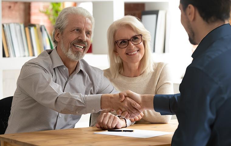 technician shaking homeowners hand