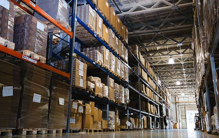 interior of a stocked industrial warehouse serviced by pest control consultants in batavia illinois