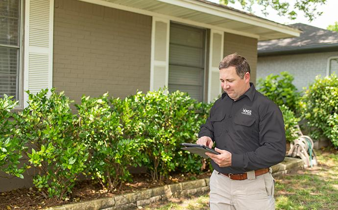 pest control consultants technician inspecting a saint charles illinois property for pest activity