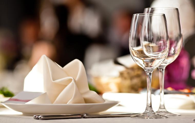 wine glasses and napkin on restaurant table