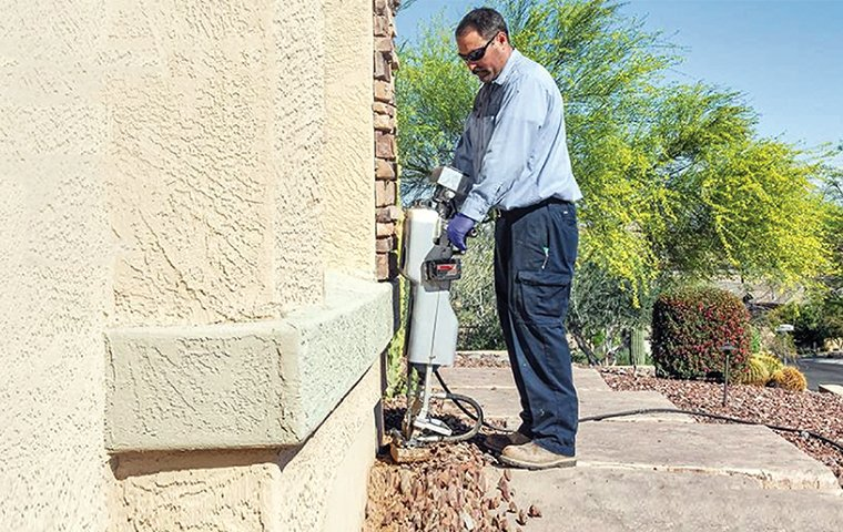 pest technician treating for termites