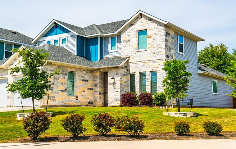 exterior view of a residential home serviced by dynasty pest control in midlothian texas