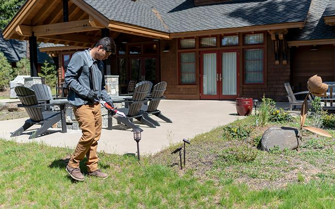 exterior ant control treatment being performed outside a grandview washington home