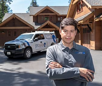 a prosite pest control service expert in front of a beautiful home in washington