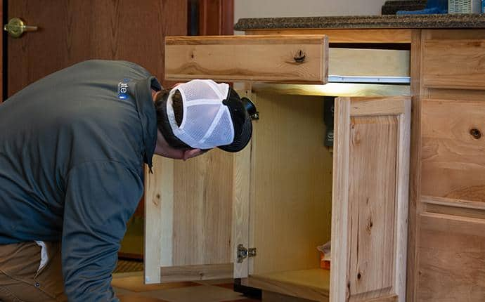 a technician performing an inspection in a yakima home