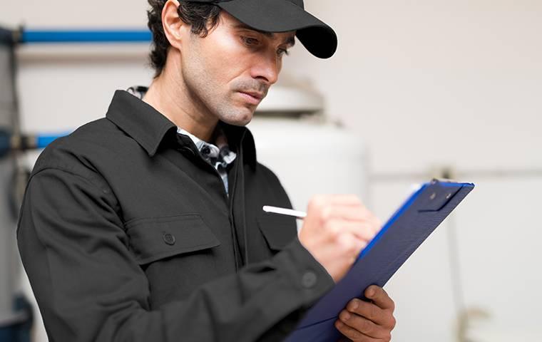 a tech inspecting inside a home