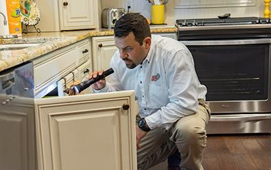 adams technician inspecting residential kitchen