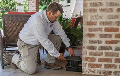 adams tech inspecting a rodent station