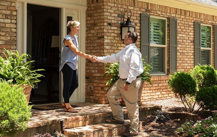 homeowner greeting pest control tech