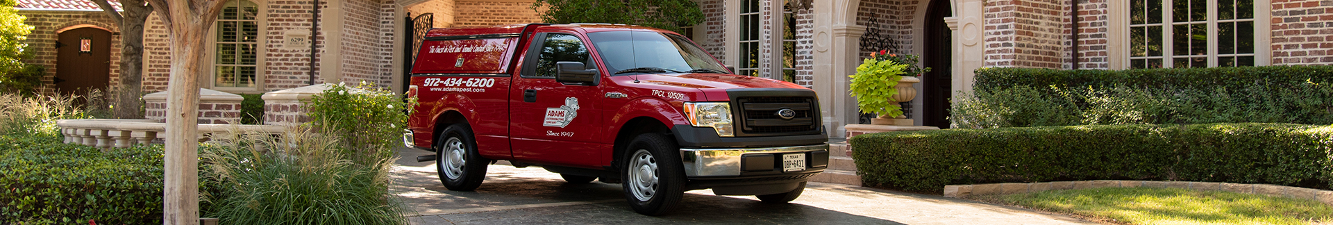 adams pest control's truck in highland village texas