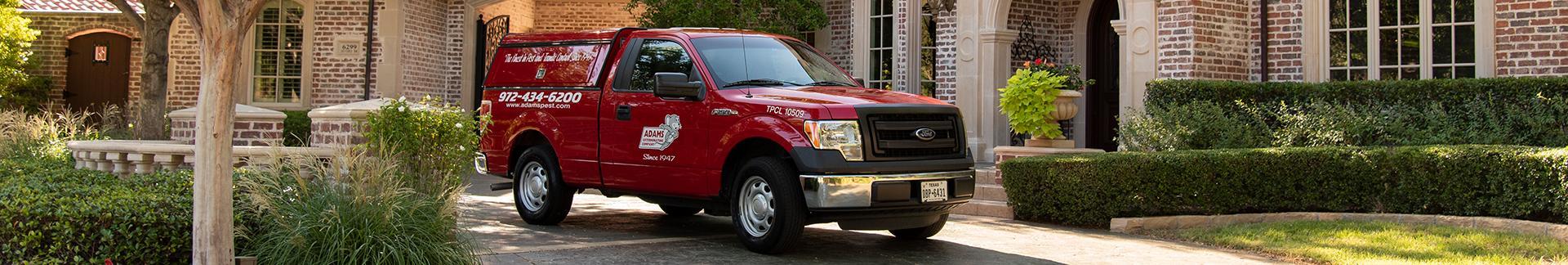 adams pest control's truck in roanoke tx